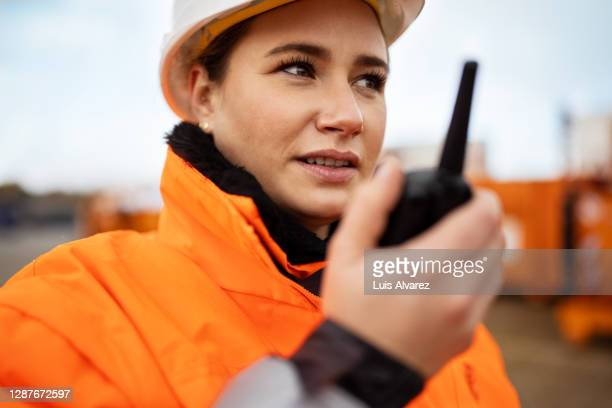 foreman talking over walkie talkie in plant - radio stock pictures, royalty-free photos & images