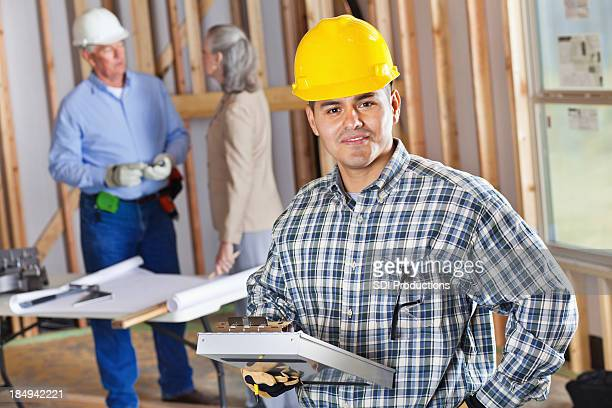Foreman with clipboard at construction site