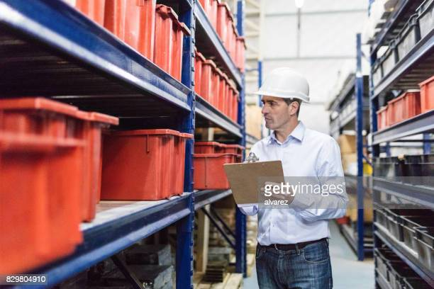 Foremen taking inventory in company warehouse
