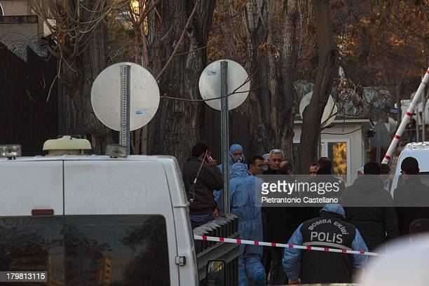 Forensic and bomb disposal teams work on the scene of the suicide bombing at U.S. Embassy in Ankara.
