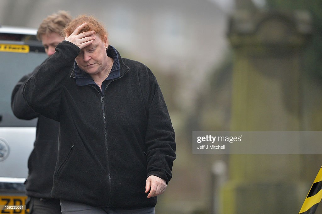 Forensic anthropologist Professor Sue Black of Dundee University reacts following the conformation that a grave at Old Monkton cemetery does not contain the body of missing schoolgirl Mora Anderson, on January 10, 2013 in Coatbridge, Scotland. Forensic specialist have spent the past three days exhuming the family burial plot of Sinclair Upton, an acquaintance of Alexander Gartshore, a former bus driver and convicted rapist linked to the disappearance of Moira. The 11-year-old school girl went missing in 1957.