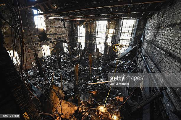 Forensic archaeologists begin sifting through the ashes of the fire damaged Mackintosh Library at the Glasgow School of Art on November 18 2014 in...