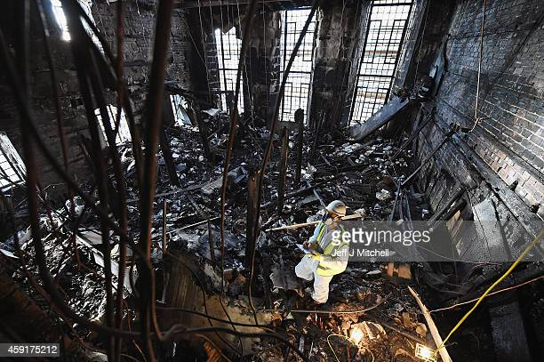 Forensic archaeologists Edward Rayner begins sifting through the ashes of the fire damaged Mackintosh Library at the Glasgow School of Art on...