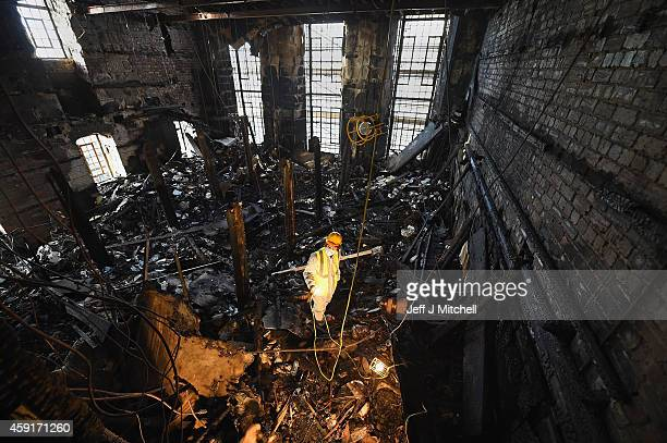 Forensic archaeologists Owen Godbert begins sifting through the ashes of the fire damaged Mackintosh Library at the Glasgow School of Art on November...