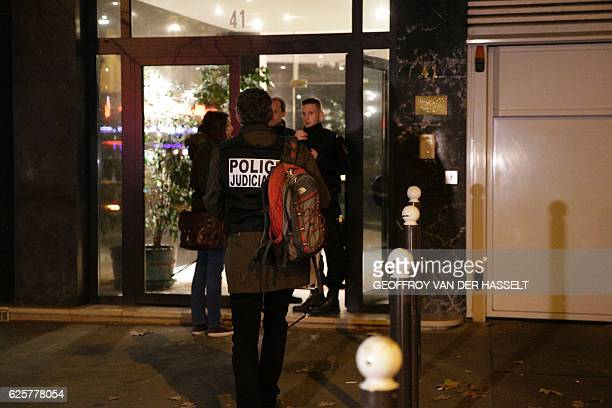 A forensic arrives as French police officers stand guard at the entrance of the building where British photographer David Hamilton was found dead at...