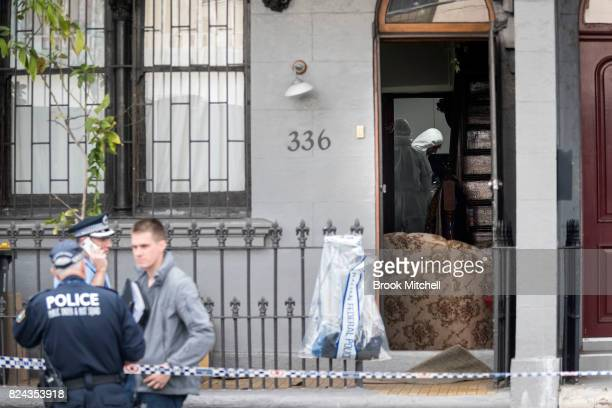 Forensic detectives search the scene of an overnight terror raid in Surry Hills on July 30 2017 in Sydney Australia Counter terrorism police raided...