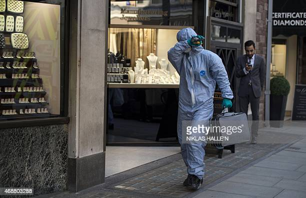 Forensic expert arrives at the Hatton Garden Safe Deposit Limited on April 7, 2015 in London. Thieves have raided some 300 deposit boxes in London's...