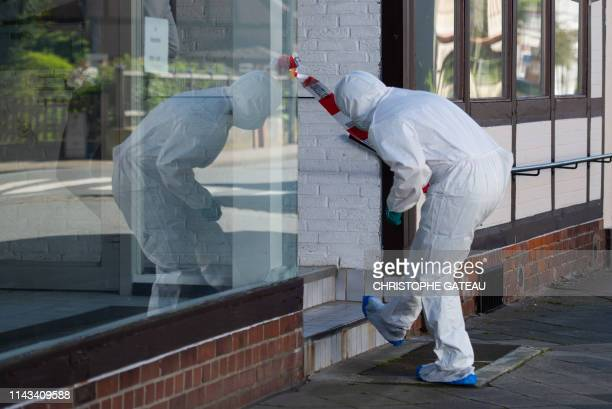 A forensic expert arrives to secure evidences on May 13 2019 in a cordoned off house in Wittingen northern Germany where two bodies were found during...