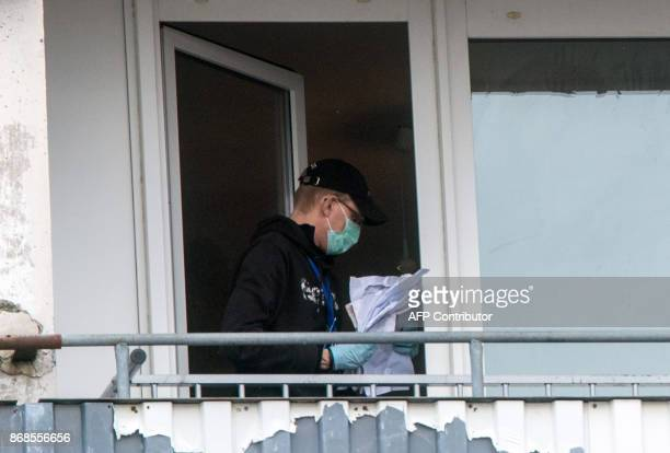 A forensic expert of the police secures evidences in a flat of an apartment house at the Neu Zippendorf district in Schwerin northeastern Germany...