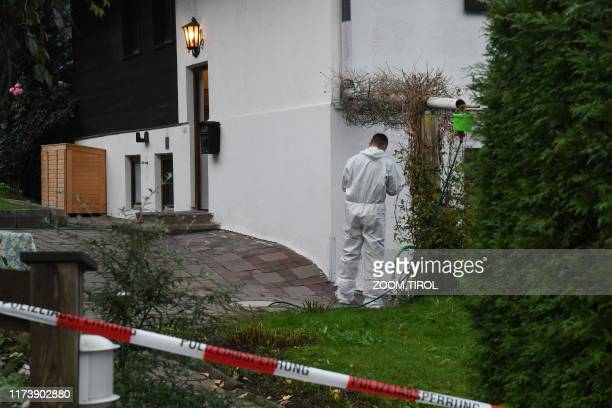 A forensic expert of the police secures the crime scene around a house in Kitzbuehel Austria where five people were killed on October 6 2019 /...