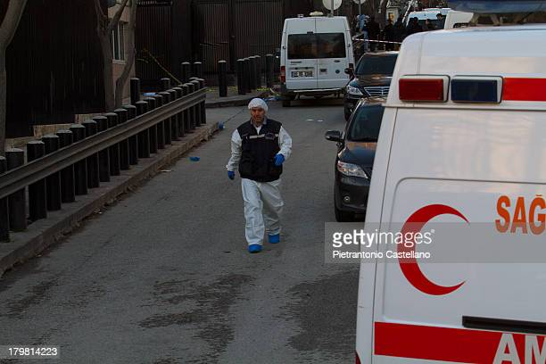 CONTENT] A forensic expert walks past a Red Crescent ambulance at the scene of the suicide bombing of US Embassy in Ankara