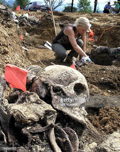 A forensic expert works in a mass grave in the village of Budak located some 2 kilometers from a memorial center for the Srebrenica massacre victims...