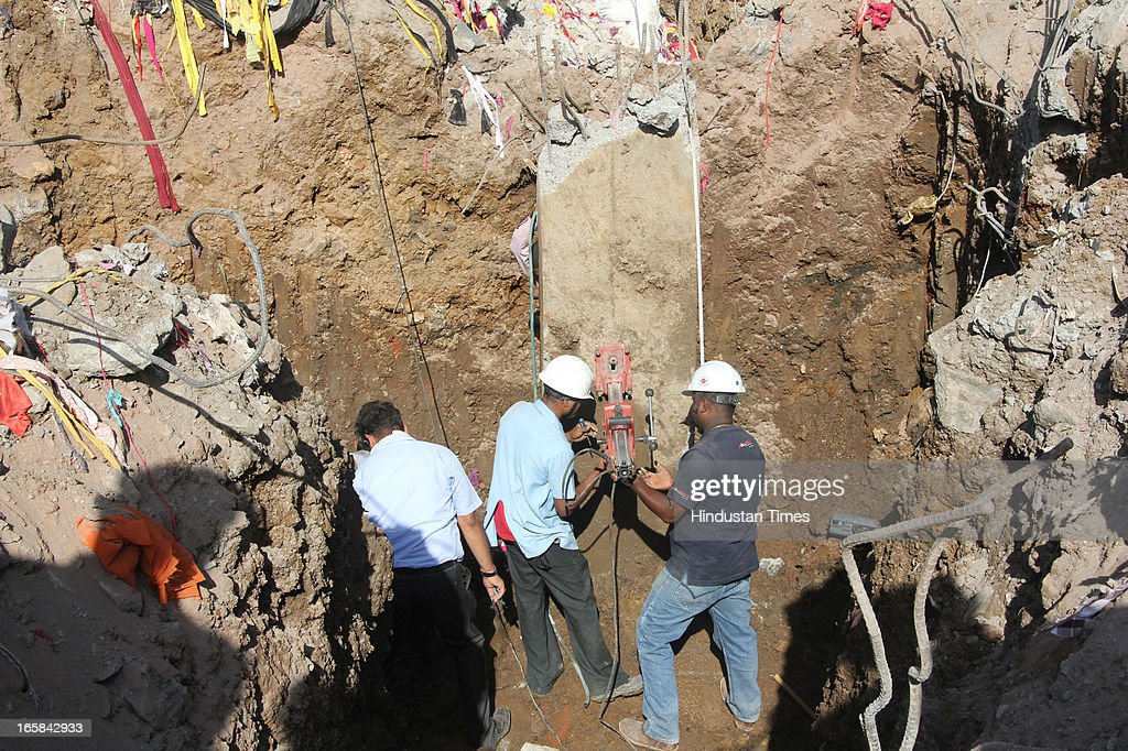 Forensic experts collect samples from the construction site to test the quality of the material used in 7-storey illegal structure that caved in here claiming 72 lives was situated on on April 6, 2013 in Thane, India. Rescue operations were called off after 62 people were pulled out of the debris. Thane Municipal corporation pulled down the other two buildings in the compound.