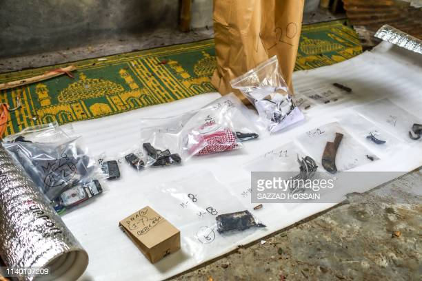 Forensic experts gather evidence after a raid operated by Bangladesh security forces on a suspected militants hideout in Dhaka on April 29 2019...