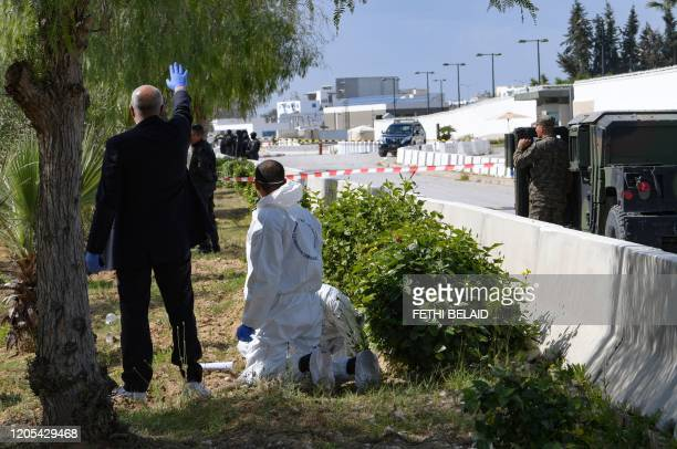 Forensic experts investigate at the scene of an explosion near the US embassy in the Tunisian capital Tunis on March 6 2020 A blast that rocked Tunis...