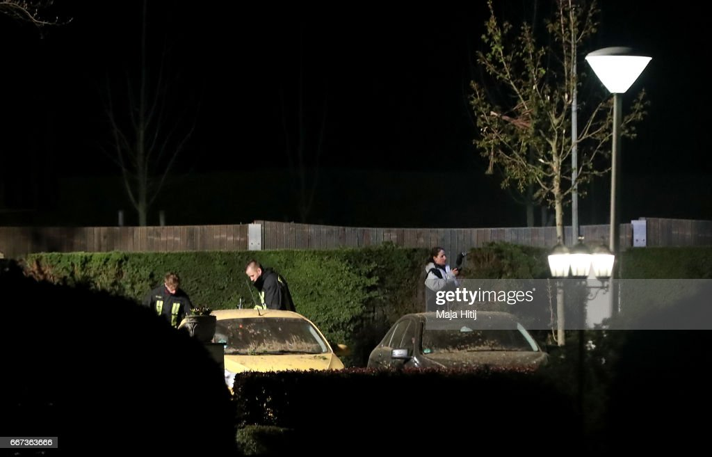 Forensic experts investigate the area where the team bus of the Borussia Dortmund football club was damaged in an explosion on April 11, 2017 in Dortmund, Germany. According to police an explosion detonated as the bus was leaving the hotel where the team was staying to bring them to their Champions League game against Monaco. One person, team member Marc Bartra, is reported injured.