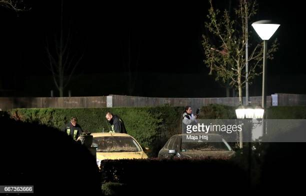 Forensic experts investigate the area where the team bus of the Borussia Dortmund football club was damaged in an explosion on April 11 2017 in...