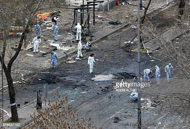 Forensic experts investigate the scene of an explosion on March 14 2016 the day after a suicide car bomb ripped through a busy square in central...