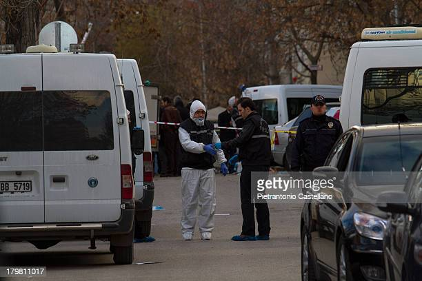CONTENT] Forensic experts of Crime Scene unit of police collect evidences after the suicide bombing that hit US Embassy in Ankara