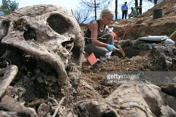 Forensic experts work in a mass grave in the village of Budak located some twoandahalf kilometers from a memorial center for the massacre victims...
