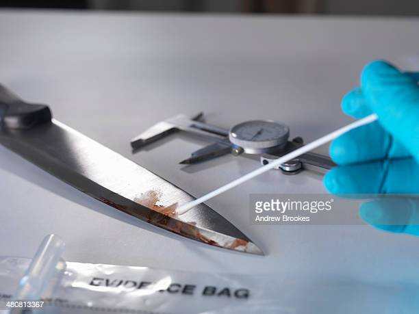 Forensic investigation of knife from crime scene