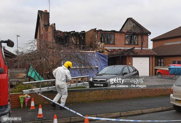 A forensic investigator at the scene after a house fire in Peartree Road Kirton near Boston in Lincolnshire where police have launched a...