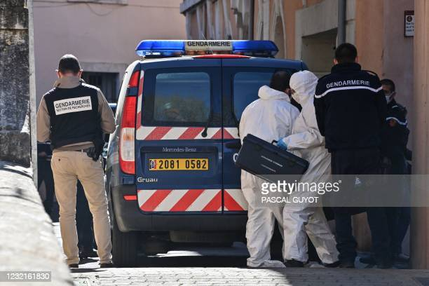 Forensic investigator of the French gendarmerie works in Bedarieux, southern France, on April 7 during an investigation on location after a body was...