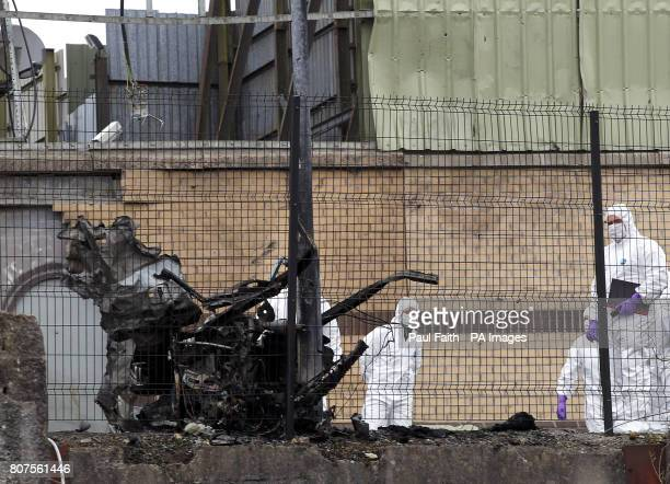 Forensic investigators a the scene of the car bomb attack in Newtownhamilton County ArmaghTwo people have been injured in a car bomb explosion...