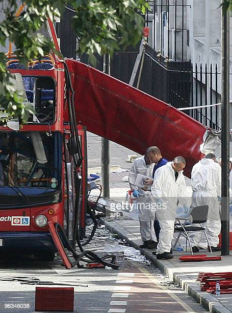Forensic investigators examine the remains of the bombed out bus in Tavistock square in London 09 July 2005 None of the bodies of the more than 50...