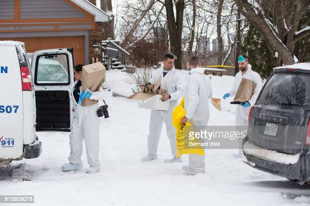 TORONTO ON FEBRUARY 8 Forensic investigators remove evidence from inside the home at 53 Mallory Cresc Toronto Planters containing body parts linked...