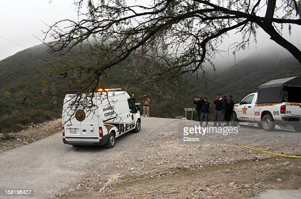 Forensic Medical Service staff move the remains of singer Jenni Rivera who died on December 09 2012 in a plane crash near the ranch on Tejocote in...