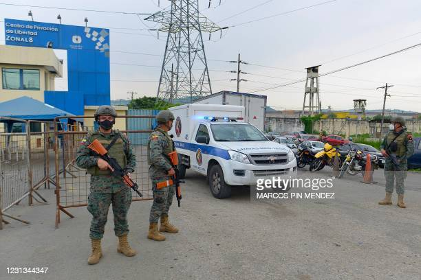 Forensic medicine ambulance gets out the Zone 8 Deprivation of Liberty Center in Guayaquil, Ecuador, on February 23, 2021. - At least 50 inmates died...