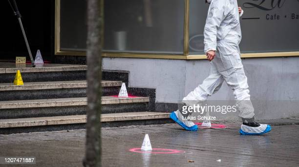 A forensic officer at the scene outside the Midnight hookah bar one of two bars that were targeted by a gunman last night on February 20 2020 in...