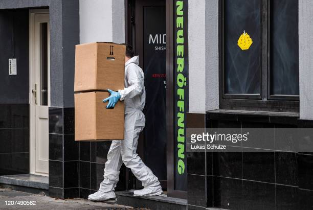 A forensic officer at the scene outside the Midnight hookah bar one of the sites of last night's shootings on February 20 2020 in Hanau Germany A...