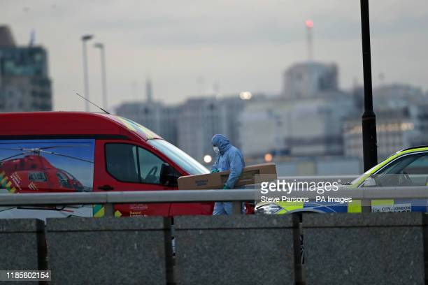 A forensic officer holding an evidence box with what appears to be part of the narwhal tusk on London Bridge in central London after a terrorist...