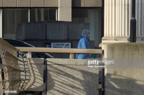 A forensic officer investigates the scene of yesterday's London Bridge stabbing attack on November 30 2019 in London England A man and a woman were...