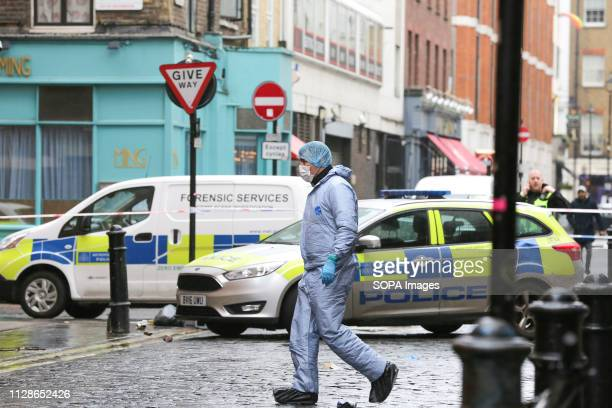 A forensic officer is seen at the crime scene outside The Coach and Horses pub in Romilly Street in Soho According to the police a man aged 30 yrs...