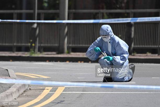 A forensic officer uses a swab outside Forbury Gardens on June 22 2020 in Wokingham England Khairi Saadallah a 25yearold refugee from Libya was...