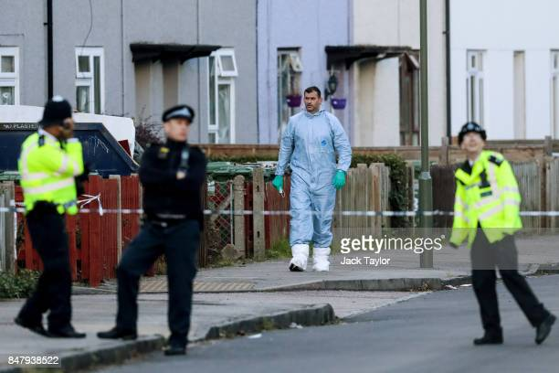 A forensic officer walks down Cavendish Road during a raid in connection with the terror attack at Parsons Green station on September 16 2017 in...