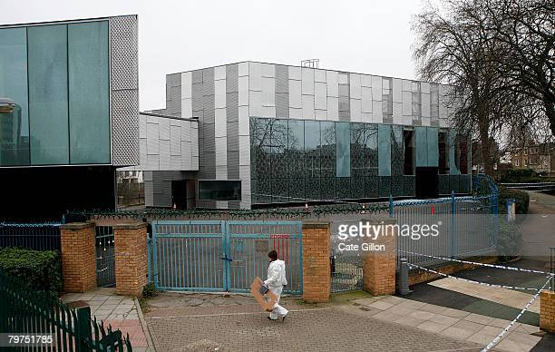 A forensic officer walks outside the Stephen Lawrence Centre on February 14 2008 in Deptford London The centre which is a tribute to the murdered...