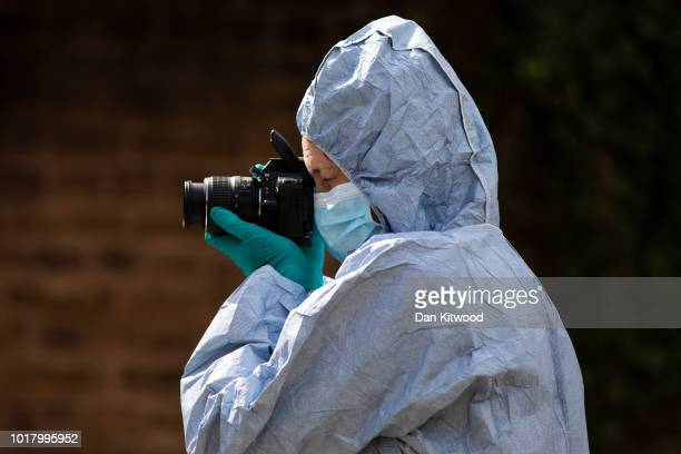 A forensic officer works at the scene in which four boys were stabbed on August 17 2018 in London England One of the boys is in critical condition...