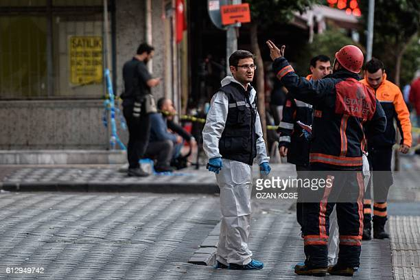 Forensic officers and firefighters work at the scene of a blast near a police station in Istanbul on October 6 2016 At least 10 people were wounded...