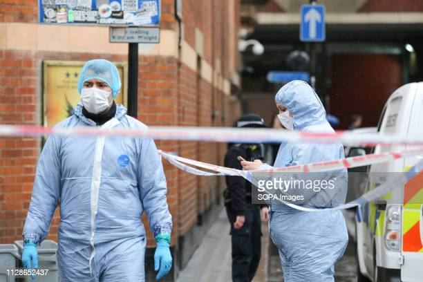 Forensic officers are seen at the crime scene outside The Coach and Horses pub in Romilly Street in Soho According to the police a man aged 30 yrs...
