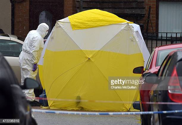 Forensic officers at the scene of the fatal shooting of former senior IRA figure, Gerard 'Jock' Davison on Welsh Street in the Markets area on May 5,...