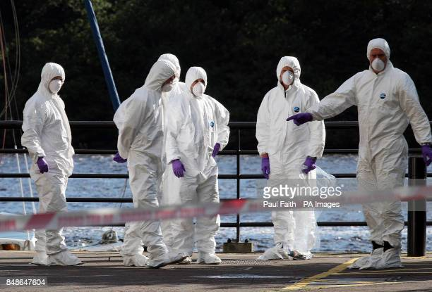 Forensic officers at the scene outside the main council offices, beside the River Foyle, in Londonderry, after dissident republicans attached a bomb...