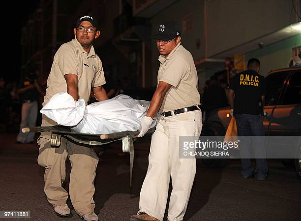 Forensic officers carry the corpse of Judge Olga Laguna allegedly murdered by hired assassins as police officers and crime scene investigators...