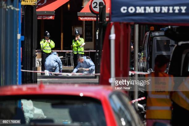 Forensic officers continue their work at one of the locations within the perimeter cordon following last night's London terror attack on June 4 2017...