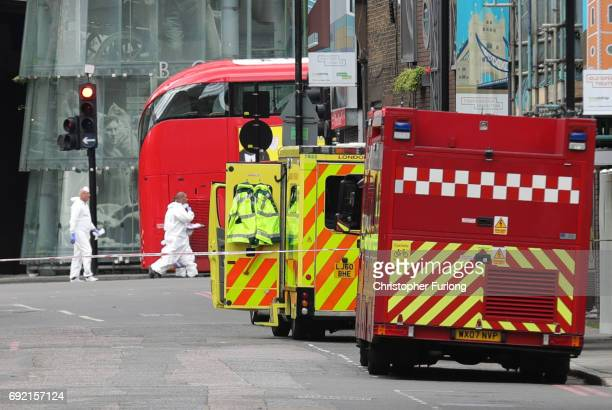 Forensic officers enter Borough Market near the scene of last night's terrorist attack on June 4 2017 in London England Police continue to cordon off...