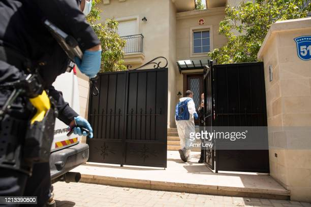 Forensic officers enter the house of China's Ambassador to Israel Du Wei, after he was found dead in his house on May 17, 2020 in Herzliya, Israel....