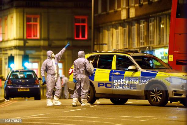 Forensic officers examine the scene where a man was shot and killed by armed police on February 2 2020 in London England The Metropolitan police have...